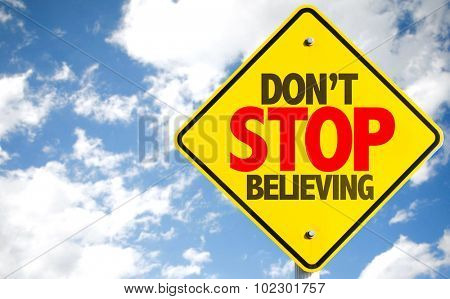 Don't Stop Believing sign with sky background