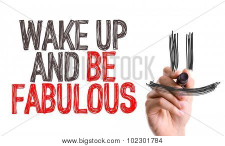 Hand with marker writing: Wake Up and Be Fabulous
