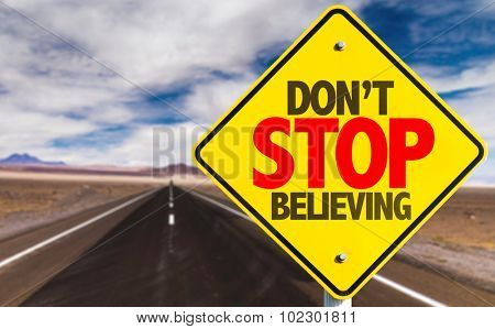 Don't Stop Believing sign on desert road