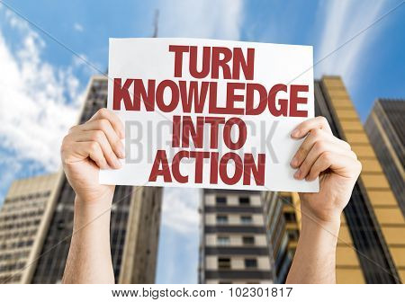Turn Knowledge into Action placard with skyscrappers background