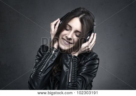 Smiling Woman With Headphones Listening Music