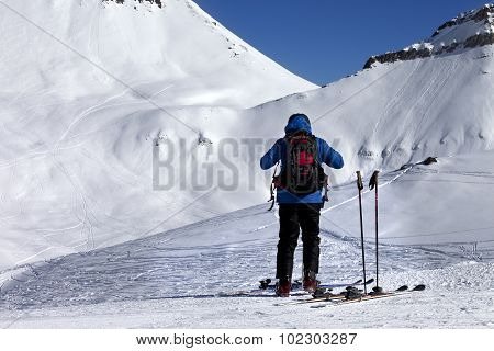 Skier On Ski Slope At Sun Day