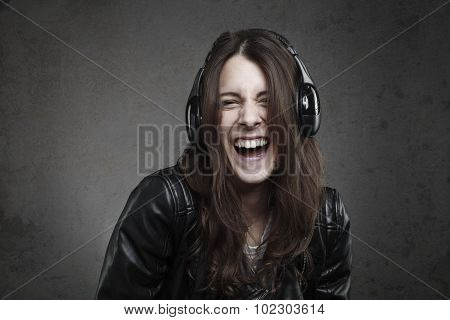 Laughing Young Woman With Headphones Listening Music