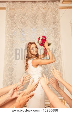 Cute Bride Throws Her Bouquet.