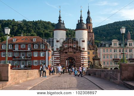 People At The Old Bridge Of Heidelberg In Germany
