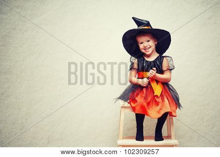 Halloween. Cheerful Little Witch With A Magic.