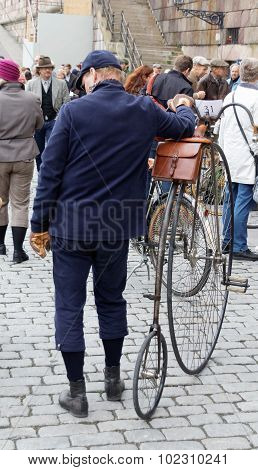 Man With Old Bicycle Wearing Old Fashioned Blue Clothes