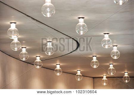 Lightbulbs Arranged In Pattern In Room Ceiling