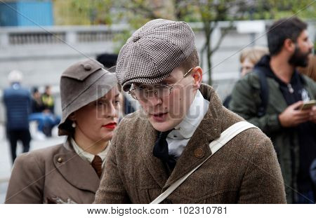 Man And Woman Wearing Old Fashioned Tweed Clothes