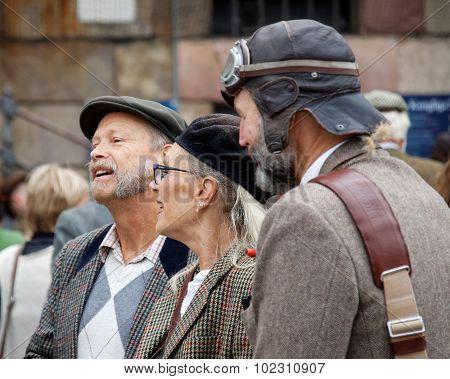 Elegant Lady And Two Older Men Wearing Tweed