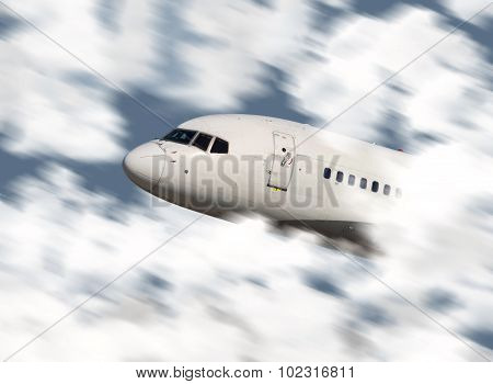 Close up of an airplane's nose flying through the clouds