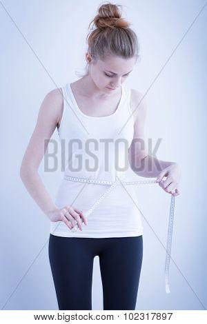 Skinny Girl Measuring Waist