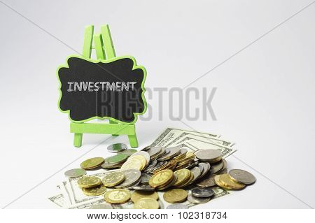 Investment Text And Money - Business Concept