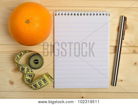 Notebook With Orange Fruit