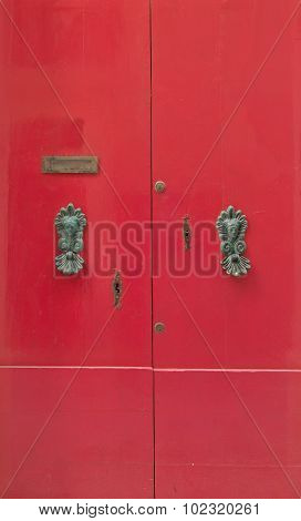 Red Door With Brass Knobs
