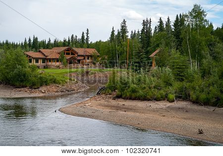 Log Home Along The River