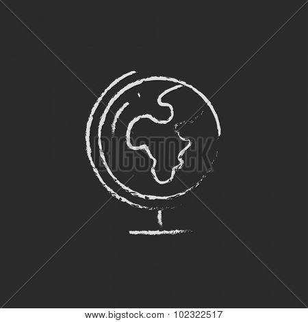 World globe on stand hand drawn in chalk on a blackboard  white icon isolated on a black background.