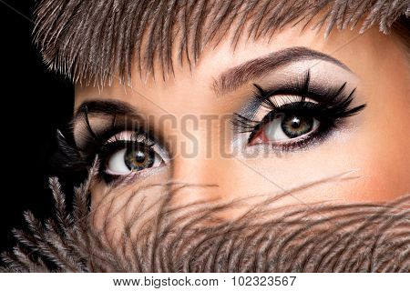 CLoseup female eye with beautiful fashion makeup with long false eyelashe