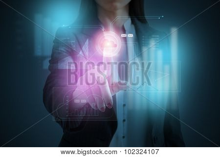 businesswoman pressing button on virtual screen of cloud computing over dark background