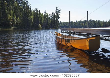 Canoe Tied To A Dock On A Northern Minnesota Lake