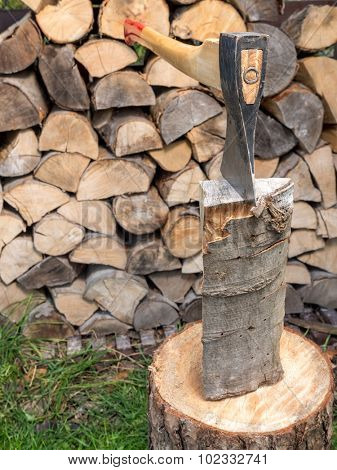 Chopping block with axe driven into log