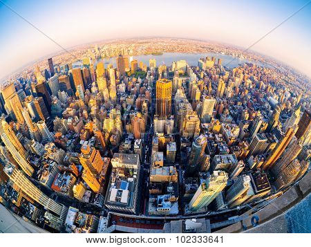 Fisheye aerial view of midtown New York City at sunset