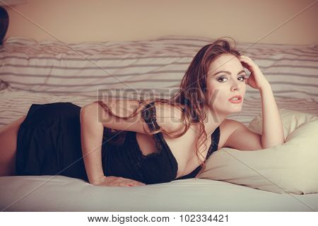 Seductive Young Woman In Lingerie In Bed.