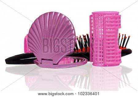 Set of cosmetics - hairbrush, hair curlers and small mirror