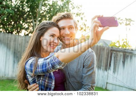 Cute couple taking selfies together