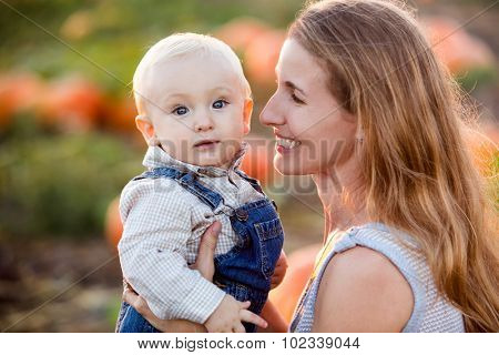 Mother son in a pumpkin patch