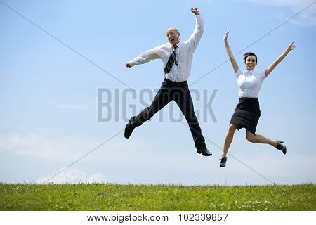 Portrait of business couple enjoying in park