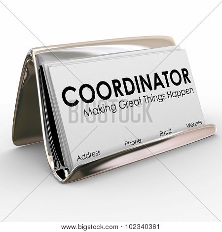 Coordinator word on business cards in a holder to illustrate a job or position for a task or work supervisor, director or manager