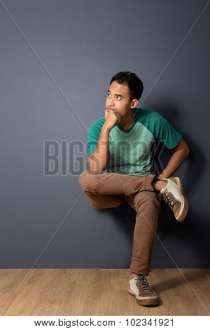 Young Man Sitting Comfortably, Thinking