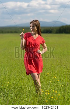 20 Year-old Girl In A Red Dress With A Yellow Flower