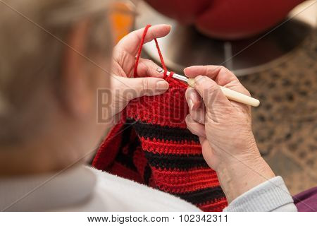 Senior Woman With A Crochet Needle And Wool
