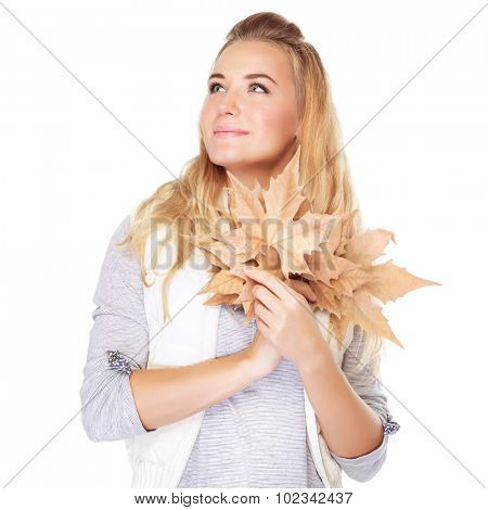Portrait of cute dreamy girl with dry leaves bouquet in hands looking on a side, isolated on white background, autumn season