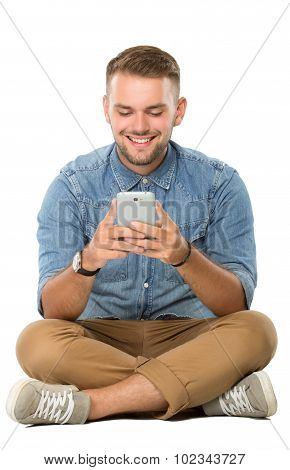 Young Man Reading Something On His Cellphone