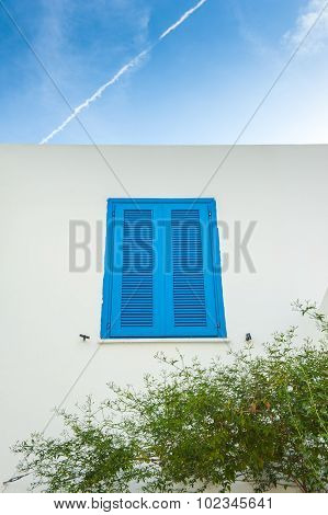 Blue Shutter Window And Sky With Contrail