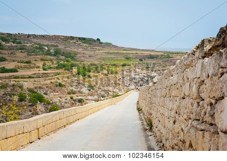 Long Road Down From Hill In Gozo Island