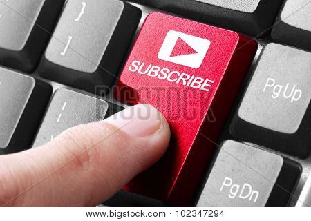 Hand Press Subscribe Button On Keyboard