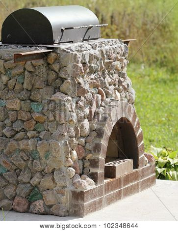 Outdoor fireplace from stone