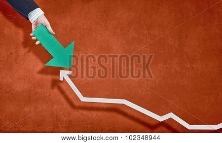 Hand holding arrow representing business growth concept