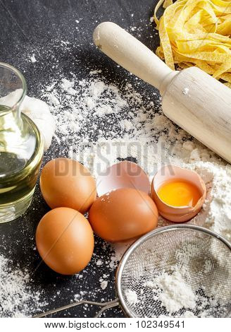 Raw Egg Yolk With Flour, Raw Homemade Fettucine And Rolling Pin