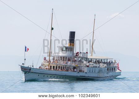 MONTREUX - JULY 16: Ship with flag of La Suisse built in 1910, belongs to founded in 1873 Belle Epoq