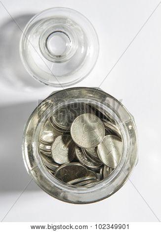 UAE Dirham coins in an open jar - top view