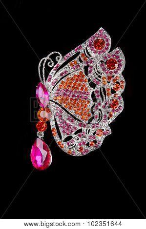 a golden butterfly gem encrusted brooch