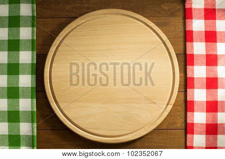 napkin and cutting board on wooden background