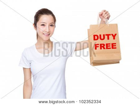 Woman carry with shopping bag and showing phrase of duty free