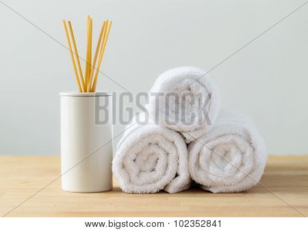 Scented woods and white towel for spa