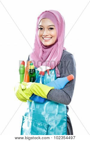 Young Housewife Carrying Many Bottles Of Cleaning Fluid